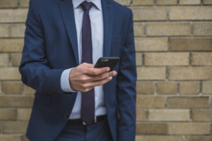 businessman-on-smartphone_925x
