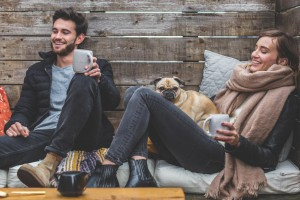 smiling-man-woman-pug_925x